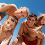 Happy family in swimwear